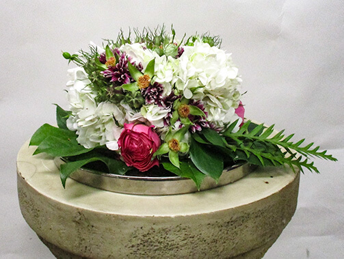 Hydrangeas plus more for a delicious looking floral cake.